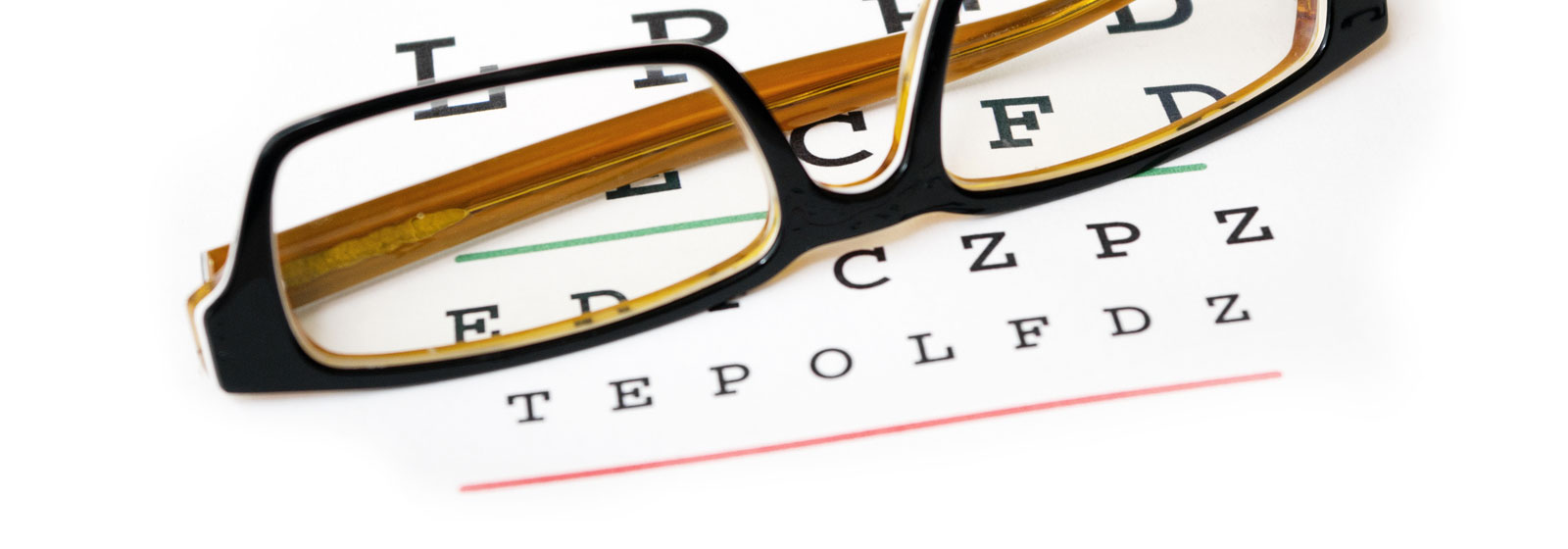 eye glasses on an eye chart